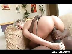 Gorgeous blond lady is passionately jumping on big black dong.