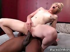 Miley May sits down on massive black cock and rides it.