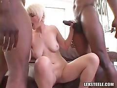 Lovely blonde is ready to have fun with two black studs.